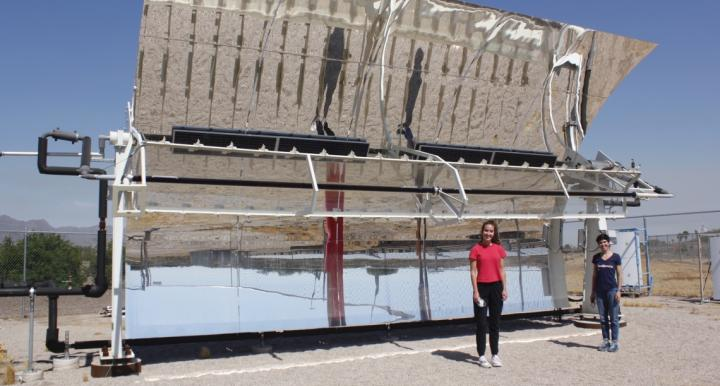 Kerri Hickenbottom and Mikah Inkawhich in front of a solar-powered desalination system