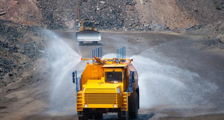 An environmentally safe biocompatible polymer blend that can be mixed with water and applied with existing equipment provides a new option for dust control.